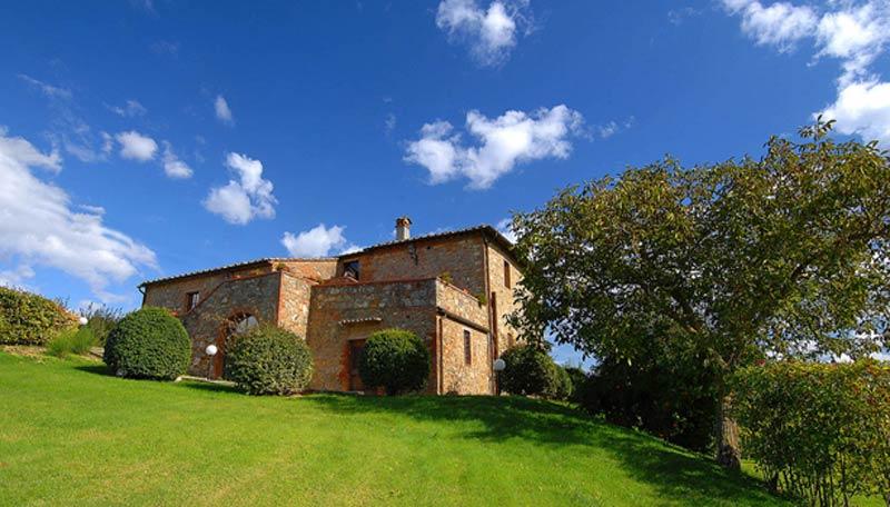 Tuin en gebouw van trouwlocatie Villa Palagetto